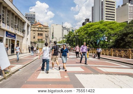 SAO PAULO, BRAZIL - OCT 24: Unidentified People walk in Santa Efigenia viaduct on October 24, 2013 in Sao Paulo, Brazil. Santa Ifigenia is located in downtown with exclusive use for pedestrians.