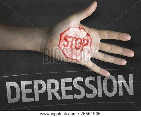 Educational and Creative composition with the message Stop Depression on the blackboard