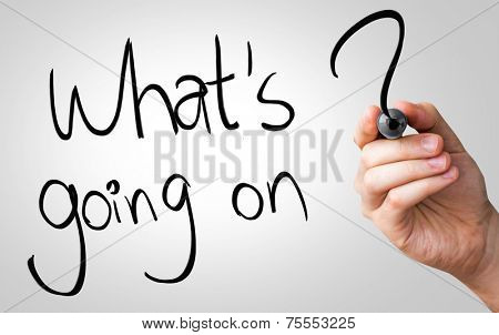 Whats going on hand writing with a black mark on a transparent board