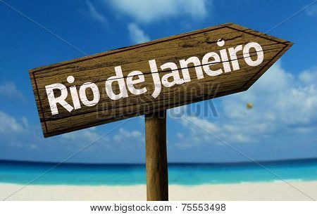 Rio de Janeiro, Brazil wooden sign with a beach on background