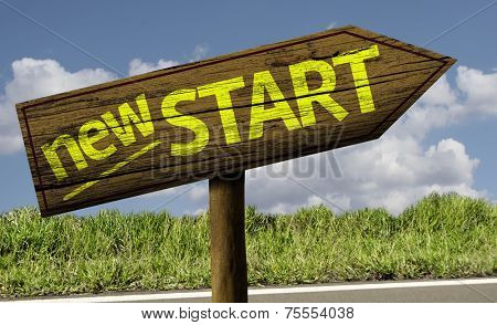 New Start wooden sign on the road