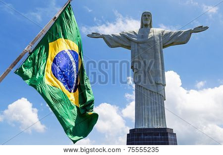 The flag of Brazil and the Christ (Cristo Redentor) in Rio de Janeiro, Brazil