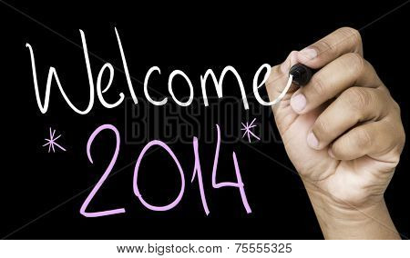 Welcome 2014 hand writing with a white mark on a transparent board