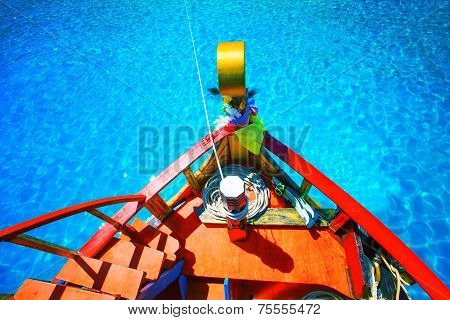 Colorful Of Wood Boat Against Beautiful Clear Blue Sea Water With Clear Water Reflection