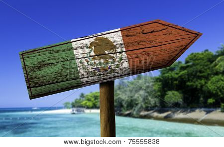 Mexico flag wooden sign with a beach on background - Central America