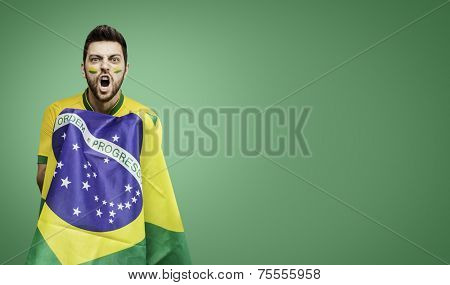 Brazilian man celebrates on green background