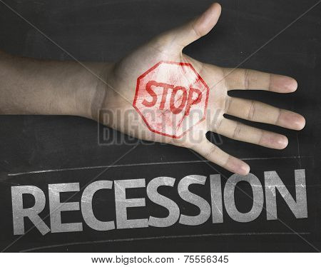 Educational and Creative composition with the message Stop Recession on the blackboard