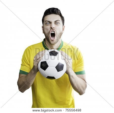Brazilian man holding a soccer ball celebrates on white background. Can be used as Australian uniform too.