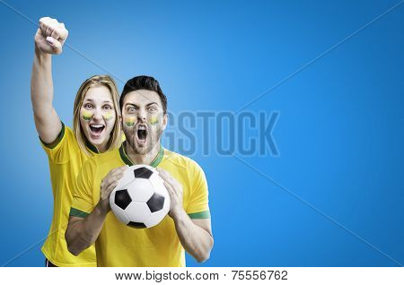 Brazilian couple celebrate on blue background