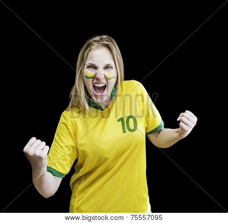 Brazilian woman celebrates on black background with her face painted