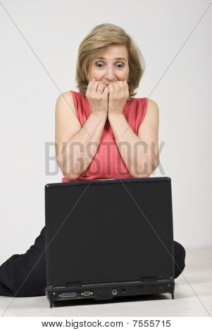 Scared Woman Using Laptop