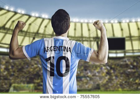 Argentine soccer player celebrates with the fans on the stadium