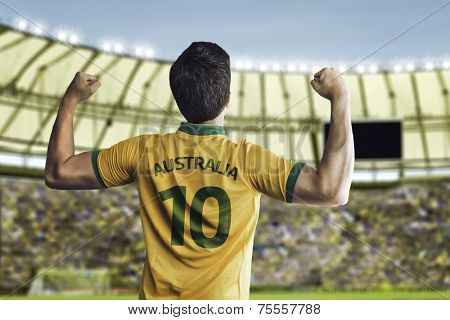 Australian soccer player celebrates with the fans on the stadium