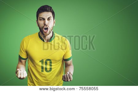 Brazilian soccer player celebrates on green background. Can be used as Australian uniform too