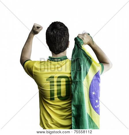 Brazilian soccer player holding the flag of Brazil celebrates on white background