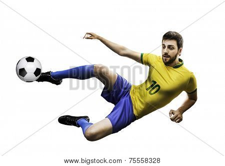 Brazilian soccer player in the jump, kicks the ball on white background