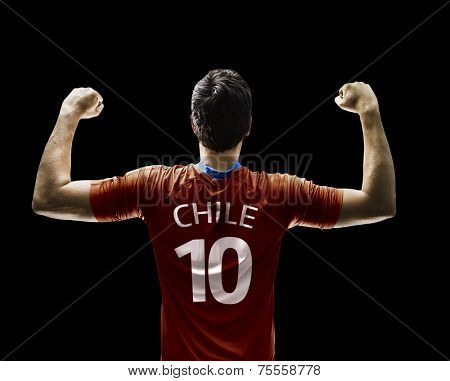 Chilean soccer player celebrates on black background
