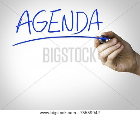 Agenda hand writing on blue marker on transparent wipe board