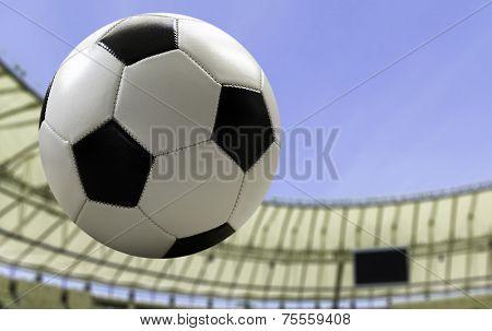 Soccer ball flying on the stadium