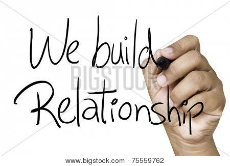 We build relationship hand writing on black marker on transparent wipe board