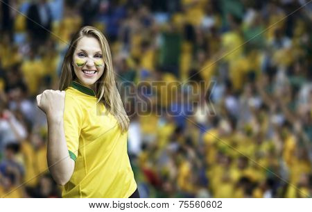 Brazilian fan celebrates on the stadium