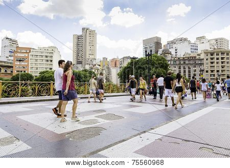 SAO PAULO, BRAZIL - CIRCA MARCH 2014: People walk in Santa Ifigenia viaduct in Sao Paulo, Brazil. Santa Ifigenia is located in downtown with exclusive use for pedestrians.