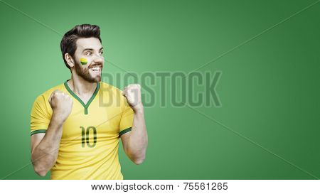 Brazilian fan celebrates on the green background