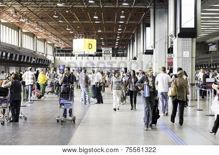 SAO PAULO, BRAZIL - CIRCA MARCH 2014: Passengers walk through Guarulhos Airport in Sao Paulo, Brazil. Guarulhos is the main airport serving Sao Paulo, Brazil.