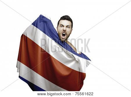 Fan holding the flag of Costa Rica celebrates on white background