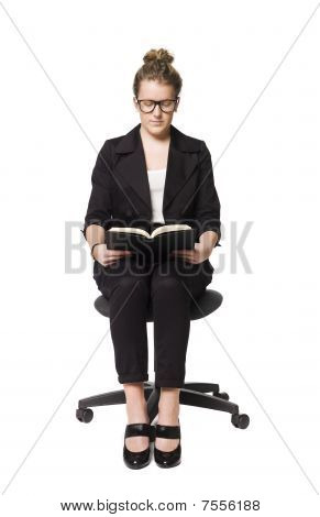 Woman on a chair with a book