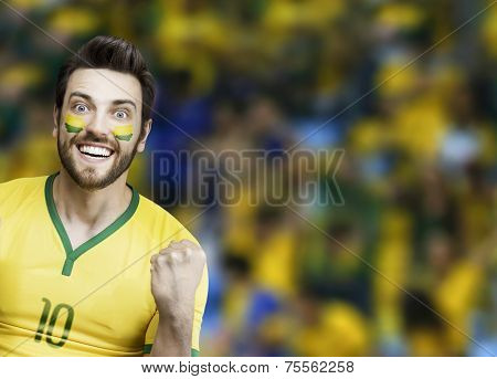 Brazilian soccer fan celebrates on the stadium
