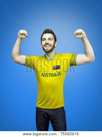 Aussie fan celebrates on blue background