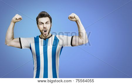 Argentinian soccer player celebrates on the blue background