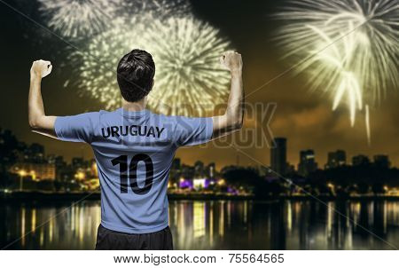 Uruguayan fan celebrates the victory after the match