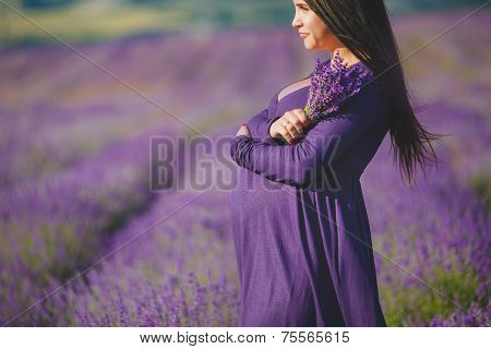 Pregnant woman in a field of lavender.