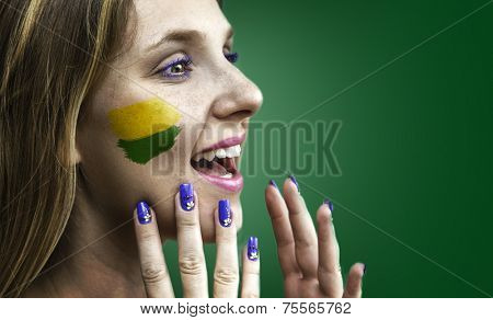 Blonde Brazilian fan celebrates on green background