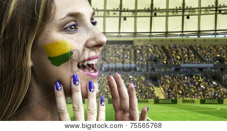 Blonde Brazilian fan celebrates in the stadium