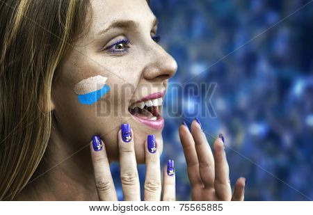Blonde Argentinian fan celebrates in the stadium
