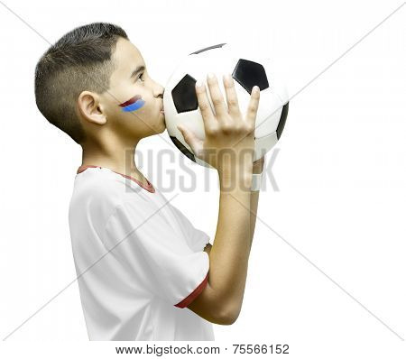 American little boy kissing a soccer ball on white background
