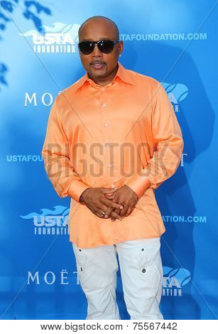 Daymond John, entrepreneur and Star of ABC Shark Tank, at the red carpet before US Open 2014 opening