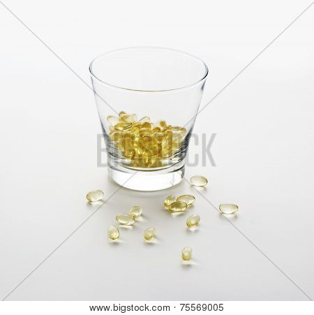 Gelatin Capsules With Fish Oil On White Background