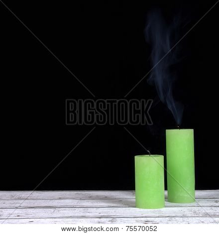 Smoke and extinct green candles