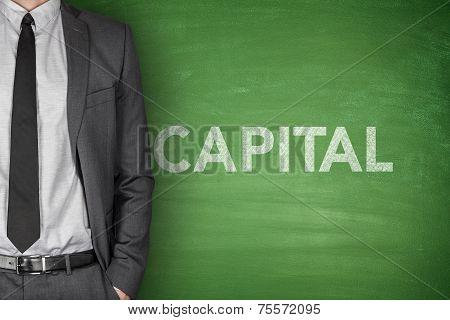 Capital on blackboard