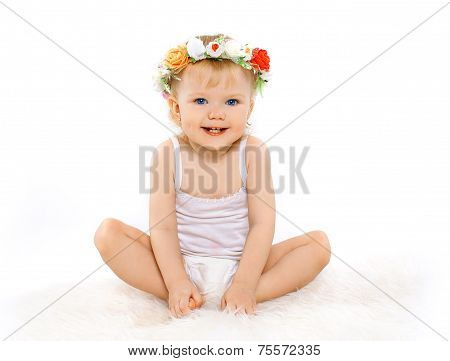 Cute Beautiful Blonde Baby Girl With Floral Wreath On His Head