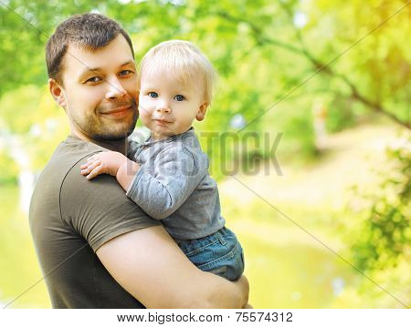 Portrait Happy Dad And Son In Summer Day