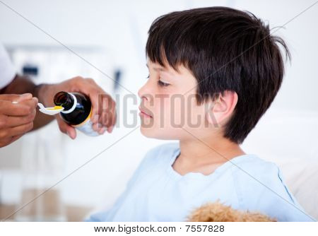 Cute Sick Little Boy Taking Medicine