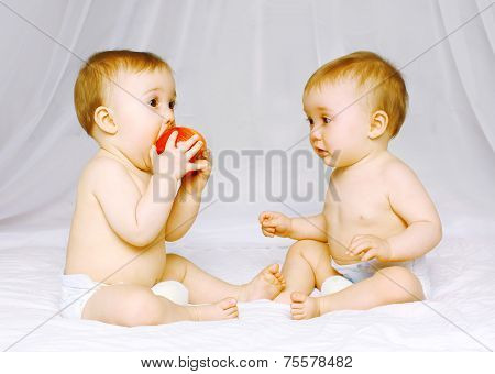 Two Babys Twins On The Bed