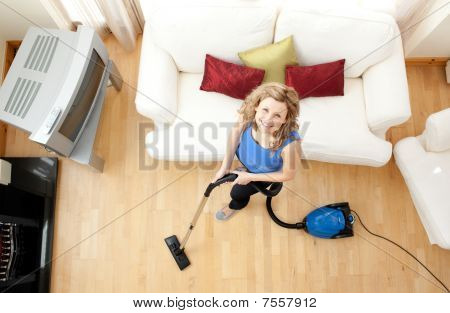 High Angle Of A Happy Woman Vacuuming
