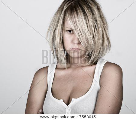 Pensive Blonde Female In White Vest
