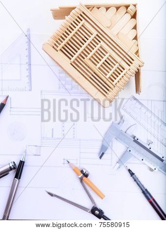 Architect Working Table With Plan Home Model And Writing Instrument And Paper Work